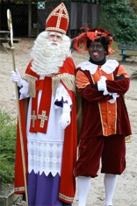 Nikolaas with Black Pete, a nicer-looking Krampus-type (Wikimedia Commons)