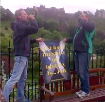 In their search for the Stone of Destiny, Stephen Crielly, left, and Richard MacFarlane blow shofars outside Edinburgh Castle.